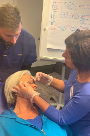 Dr Andreas teaching upper face botox