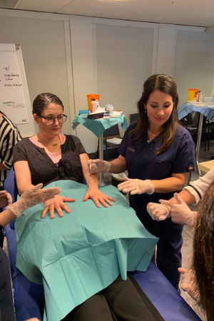 Dr Emma Sloan teaching hand rejuvenation with dermal fillers