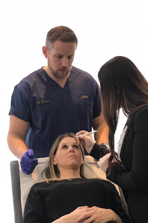 Dr Chris teaching upper face botox treatment