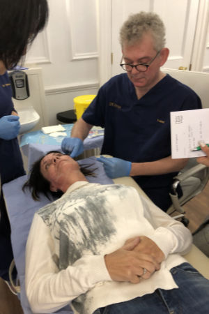 Dr Mark Holmes demnostrating PDO cog thread techniques on a patient