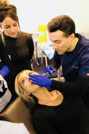 Dr Zack Ally teaching tear trough treatment using dermal fillers